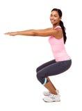 Kobieta Ćwiczy Przeciw Białemu tłu Fotografia Royalty Free