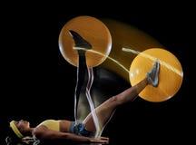 Kobieta ćwiczy sprawność fizyczną ćwiczy odosobnionego czarnego tła lightpainting skutek obraz stock