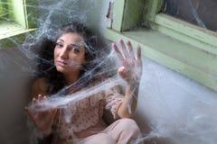Kobieta łapiąca w spiderweb Zdjęcie Royalty Free