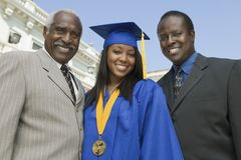 Kobieta absolwent Z ojcem I bratem Zdjęcia Royalty Free