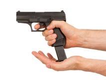 Kobieta ładuje czarnego pistolet Obrazy Stock