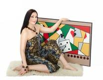 Kobieta artysty mienie z lewą ręką jej obraz obsesja fotografia stock