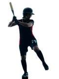 Kobieta bawić się softballi graczów sylwetkę odizolowywającą fotografia royalty free