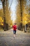Kobieta bieg w jesień parku Zdjęcie Stock