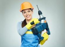 Kobieta budowniczego mienia świderu narzędzie Zdjęcie Royalty Free