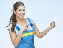 Kobieta budowniczy trzyma białego pustego reklamowego sztandaru punktu finge Zdjęcia Stock