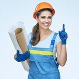 Kobieta budowniczy wskazuje palec c w jednolitych mienie projektach Obrazy Stock