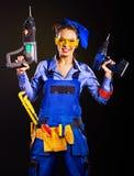 Kobieta budowniczy z budów narzędziami. Fotografia Stock