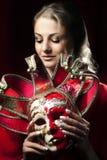 Kobieta chuje karnawałową venetian maskę Fotografia Royalty Free