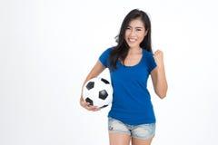 Kobieta chwyta futbol Obraz Royalty Free