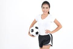 Kobieta chwyta futbol Zdjęcie Royalty Free
