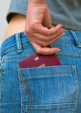 Kobieta ciągnie out europejskiego paszport Zdjęcia Stock