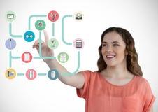 Kobieta dotyka cyfrowo wytwarzać złączone ikony przeciw białemu tłu zdjęcia royalty free