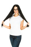Kobieta dotyka ona długie włosy fotografia stock
