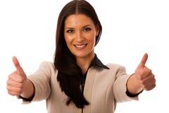 Kobieta gestykuluje sukces z aprobatami i dużym szczęśliwym uśmiechem Fotografia Stock