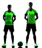 Kobieta graczów piłki nożnej odosobniona sylwetka Zdjęcie Stock