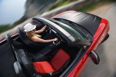 Kobieta i czerwień kabriolet Fotografia Stock