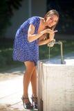 Kobieta i faucet Obraz Royalty Free