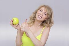 Kobieta i jabłko Obrazy Royalty Free