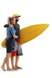 Kobieta i męski surfingowiec z surfboard Zdjęcie Stock