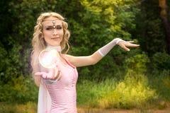 Kobieta i magiczna piłka Fotografia Royalty Free