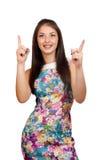 Kobieta jest przedstawiająca lub wskazująca z jej palcem Zdjęcie Royalty Free