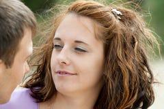 Kobieta jest przyglądająca jej chłopak Zdjęcie Stock