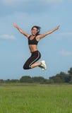 kobieta jumping Zdjęcie Stock