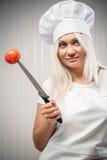 Kobieta kucharz indoors Obrazy Royalty Free