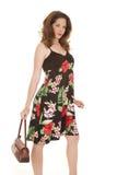 Kobieta kwiatu sukni kiesy puszek Zdjęcie Royalty Free