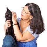 Kobieta Migdali Czarnego kota Obrazy Royalty Free