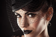 Kobieta model z czernią uzupełniał Obrazy Stock