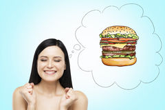Kobieta myśleć o hamburgerze Fasta food pojęcie niebieska tła Obraz Stock