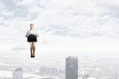 Kobieta na chmurze Obrazy Stock