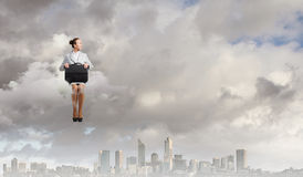 Kobieta na chmurze Zdjęcia Stock