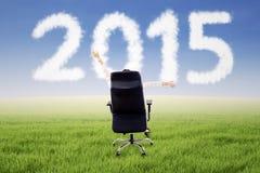 Kobieta na krześle z liczbą 2015 Zdjęcia Royalty Free