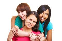kobieta obejmowanie kobiety szczęśliwa trzy obraz stock