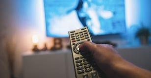Kobieta Ogląda tv i używa pilot do tv, pov strzał Obraz Royalty Free