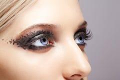 Kobieta ono przygląda się z dnia makeup Fotografia Stock