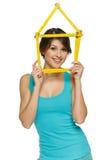 Kobieta patrzeje przez domowej ramy Fotografia Stock