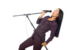 Kobieta śpiew w karaoke klubie na bielu Obraz Royalty Free