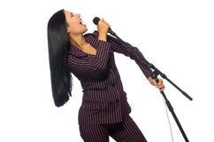 Kobieta śpiew w karaoke klubie na bielu Zdjęcie Stock