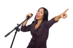 Kobieta śpiew w karaoke klubie na bielu Obrazy Stock