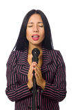 Kobieta śpiew w karaoke klubie na bielu Zdjęcie Royalty Free
