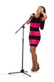 Kobieta śpiew w karaoke klubie na bielu Obrazy Royalty Free