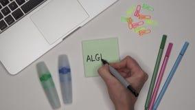 Kobieta pisze algebrze na notepad, zakończenie w górę Laptop i materiały na stole zbiory wideo