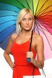 Kobieta pod mienia parasolowym torba na zakupy Fotografia Stock