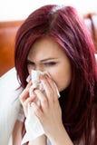 Kobieta podmuchowy nos zdjęcie royalty free