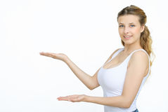 Kobieta pokazuje coś z otwartą ręki palmą Zdjęcia Stock