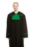 Kobieta prawnika adwokat jest ubranym czerni zieloną togę Zdjęcia Stock